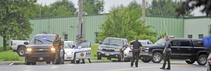 Officials from the Maine State Police, Winslow and Waterville police departments and Kennebec County Sheriff's Office converge at the scene of a robbery at the Bangor Savings Bank on China Road in Winslow on Friday.