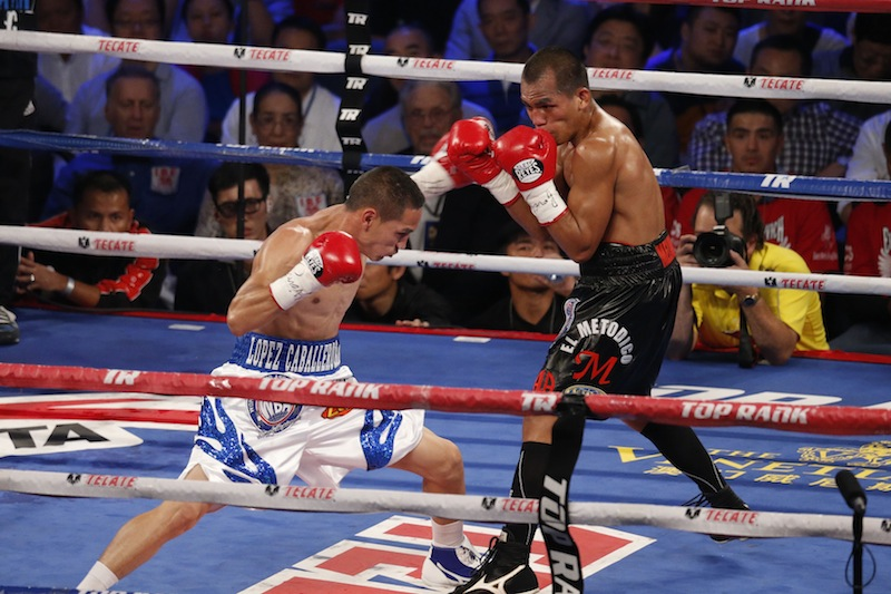 Mexico's Juan Francisco Estrada, left, fights against Milan Melindo of the Philippines during their WBO/WBA Flyweight Title match at the Cotai Arena in Venetian Macao in Macau Saturday July 27, 2013. A Chinese fighter's victory at a Macau showdown brings the world's top casino market a step closer to challenging Las Vegas for dominance of another Sin City staple: big-time boxing matches. Macau, which long ago eclipsed Vegas as the world's top gambling city, is now looking to add to its allure by holding the kind of boxing bouts that Las Vegas is known for. (AP Photo/Dennis Ho)