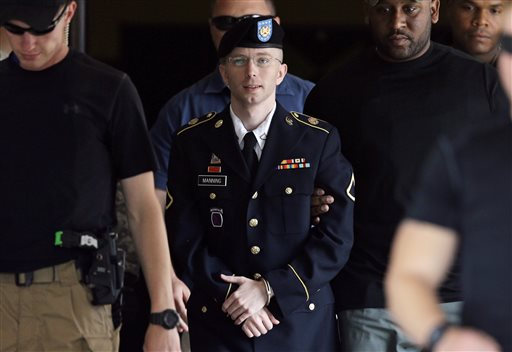 In this July 30, 2013 photo, Army Pfc. Bradley Manning is escorted out of a courthouse in Fort Meade, Md.