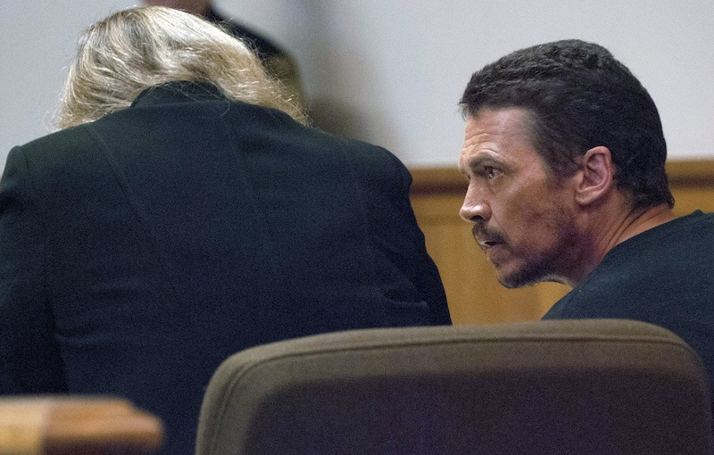 In this July 3, 2013 file photo, James Robarge sits in Superior Court in Brattleboro, Vt., during arraignment on motor vehicle charges for an incident in Bellows Falls. New Hampshire authorities say the death of a Charlestown woman who had been missing for nearly two weeks is a homicide, and they've issued an arrest warrant for Robarge, her estranged husband, on a charge of second-degree murder. The charge alleges that Robarge recklessly caused the death of 42-year-old Kelly Robarge on June 27 in Charlestown. Roberge is jailed at the Southern State Correctional Facility in Springfield, Vt., on unrelated motor vehicle charges. (AP Photo/Brattleboro Reformer, Kayla Rice, File)