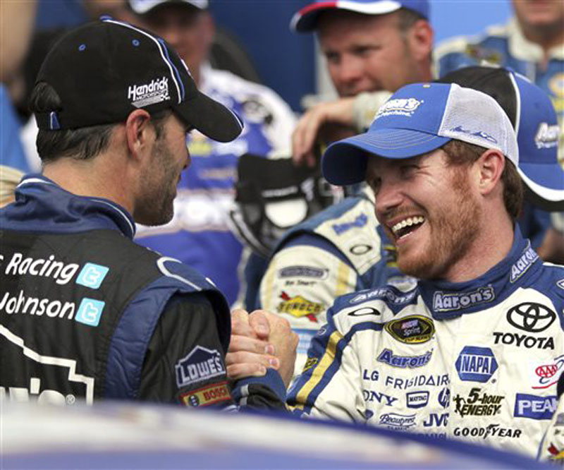 Brian Vickers, right, is congratulated by Jimmie Johnson in Victory Lane after winning the NASCAR Sprint Cup Series auto race Sunday at New Hampshire Motor Speedway in Loudon, N.H.