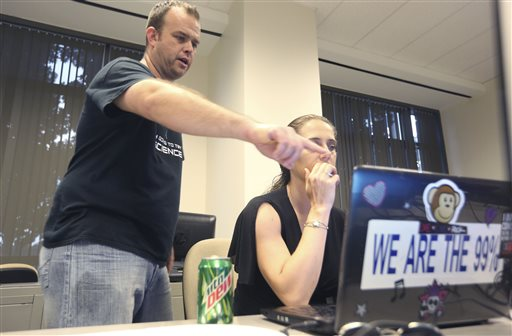 IInformation technology professional Josh Scott, left, helps a computer user who did not want to be identified during a monthly