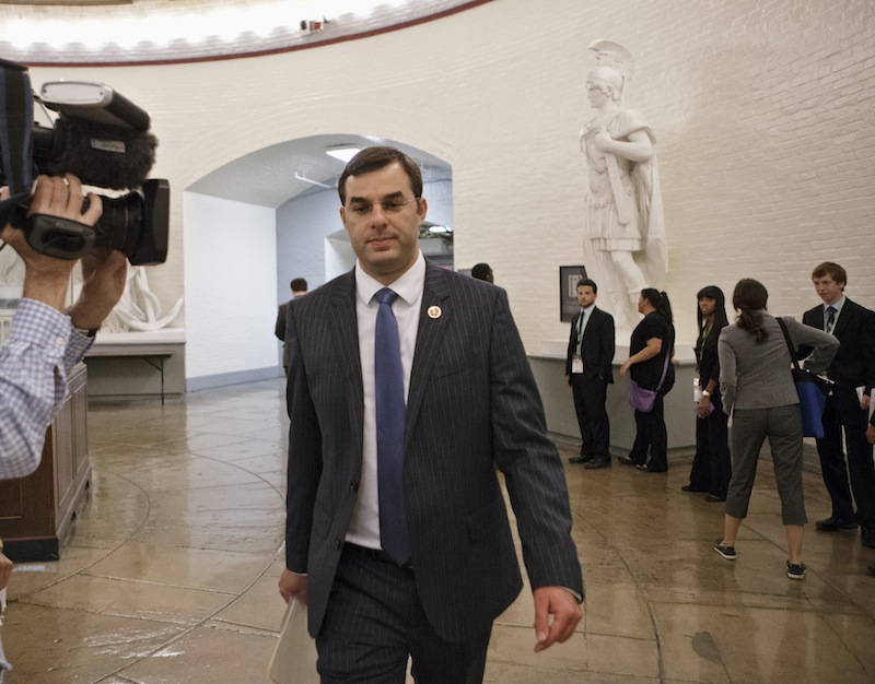 Rep. Justin Amash, R-Mich., walks through a basement corridor to the House of Representatives for the vote on his amendment to the Defense spending bill that would cut funding to the National Security Agency's phone surveillance program, on Capitol Hill, Wednesday. The measure was narrowly rejected.