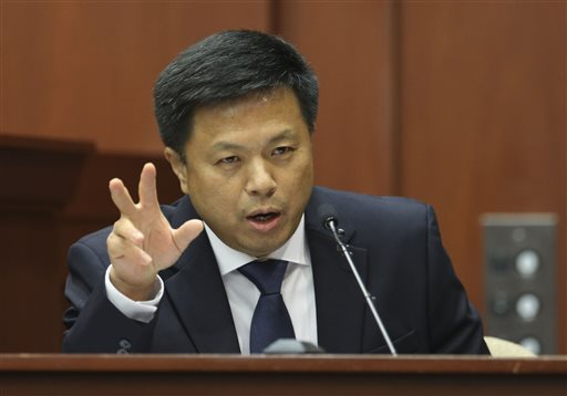 Volusia and Seminole County associate medical examiner Shiping Bao MD testifies during George Zimmerman's trial in Seminole circuit court, Friday, July 5, 2013 in Sanford, Fla. Zimmerman has been charged with second-degree murder for the 2012 shooting death of Trayvon Martin.