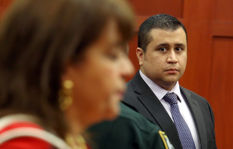 George Zimmerman looks at State Attorney Angela Corey, during a recess in his trial at the Seminole circuit court, in Sanford, Fla., Wednesday, July 3, 2013. Zimmerman is charged with second-degree murder in the fatal shooting of Trayvon Martin, an unarmed teen, in 2012. (AP Photo/Orlando Sentinel, Jacob Langston, Pool)