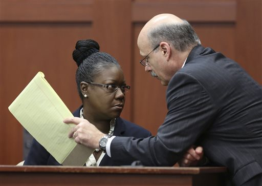Assistant state attorney Bernie de la Rionda, right, talks to Sybrina Fulton, Trayvon Martin's mother, on the stand during a recess in George Zimmerman's trial in Seminole circuit court, Friday, July 5, 2013 in Sanford, Fla. Zimmerman has been charged with second-degree murder for the 2012 shooting death of Trayvon Martin.
