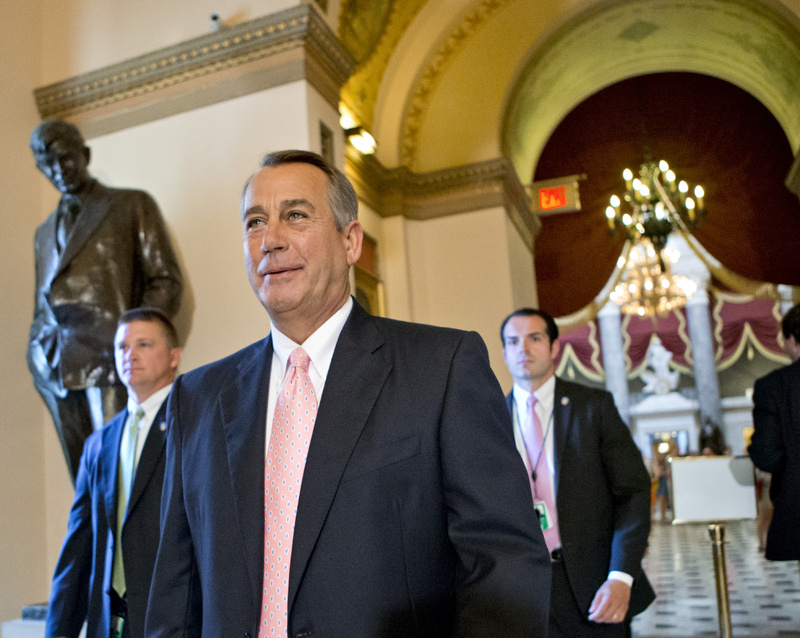 Speaker of the House John Boehner, R-Ohio, smiles as he walks to the floor of the House of Representatives as the Republican majority passed legislation to replace the No Child Left Behind law, in Washington on Friday.