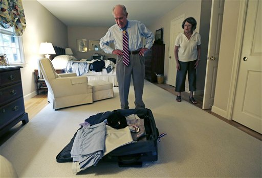 Retired U.S. Navy Capt. Thomas Hudner talks with his wife Georgea while packing for his trip to North Korea.