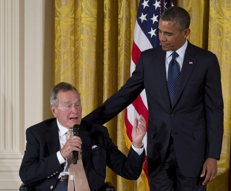 Former President George H. W. Bush speaks as President Barack Obama stands at right during a ceremony to present the 5,000th Daily Point of Light Award to Floyd Hammer and Kathy Hamilton of Union, Iowa, at the White House on Monday.