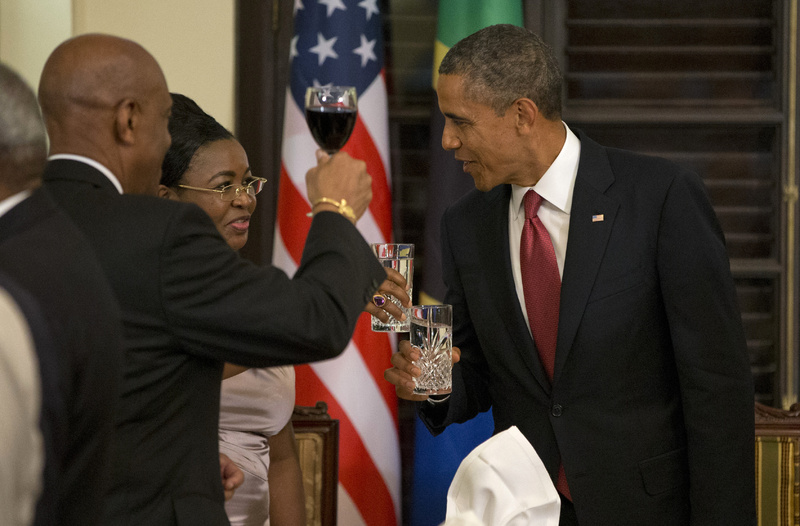 President Barack Obama toasts with Tanzanian first lady Salma Kikwete during an official dinner at the State House in Dar Es Salaam, Tanzania, on Monday. The president is traveling in Tanzania on the final leg of his three-country tour in Africa.
