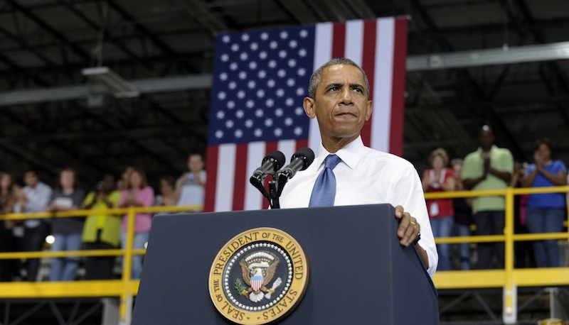 President Barack Obama speaks at the Amazon fulfillment center in Chattanooga, Tenn., Tuesday, July 30, 2013. Obama came to Chattanooga to give the first in a series of policy speeches on his proposals for private sector job growth and to strengthen the manufacturing sector. (AP Photo/Susan Walsh)