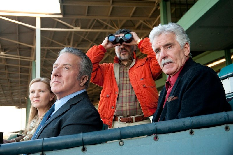 """In this undated image released by HBO, from left, Joan Allen, Dustin Hoffman, John Ortiz and Dennis Farina are shown in a scene from the HBO original series """"Luck."""" Farina died suddenly on Monday, July 22, 2013, in Scottsdale, AZriz., after suffering a blood clot in his lung. He was 69. (AP Photo/HBO, Gusmano Cesaretti, File )"""
