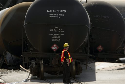 In this July 12 photo, work continues at the crash site on in Lac-Megantic, Quebec of a train that derailed igniting tanker cars carrying crude oil that killed fifty people. Maine Reps. Mike Michaud and Chellie Pingree on Wednesday urged federal regulators to finalize new design standards for the type of railroad tanker car involved in the derailment and explosions that killed dozens in Quebec earlier this month. (AP Photo/The Canadian Press, Ryan Remiorz)