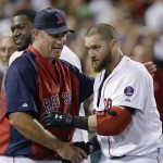 Boston Red Sox's Jonny Gomes, right, is congratulated by manager John Farrell after his pinch-hit walk-off solo home run in the ninth inning of an interleague baseball game against the San Diego Padres at Fenway Park in Boston, Wednesday, July 3, 2013. Boston won 2-1. (AP Photo/Elise Amendola)