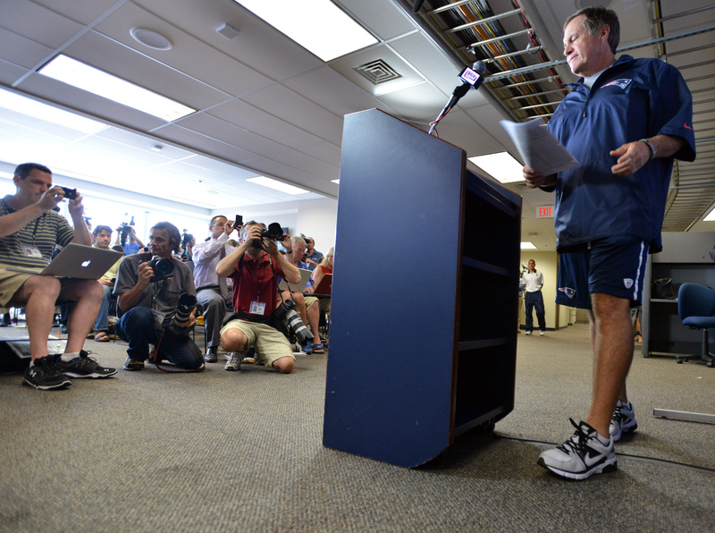 New England Patriots head coach Bill Belichick arrives to speak to reporters in Foxborough, Mass., on Wednesday.