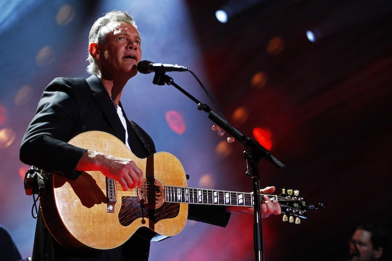 In this June 7, 2013 file photo, Randy Travis performs on day 2 of the 2013 CMA Music festival at the LP Field in Nashville, Tenn. Travis has been hospitalized in Texas with viral cardiomyopathy. A news release from the singer's publicist says Travis was admitted to the hospital Sunday, July 7, 2013, in Dallas. (Photo by Wade Payne/Invision/AP, File)