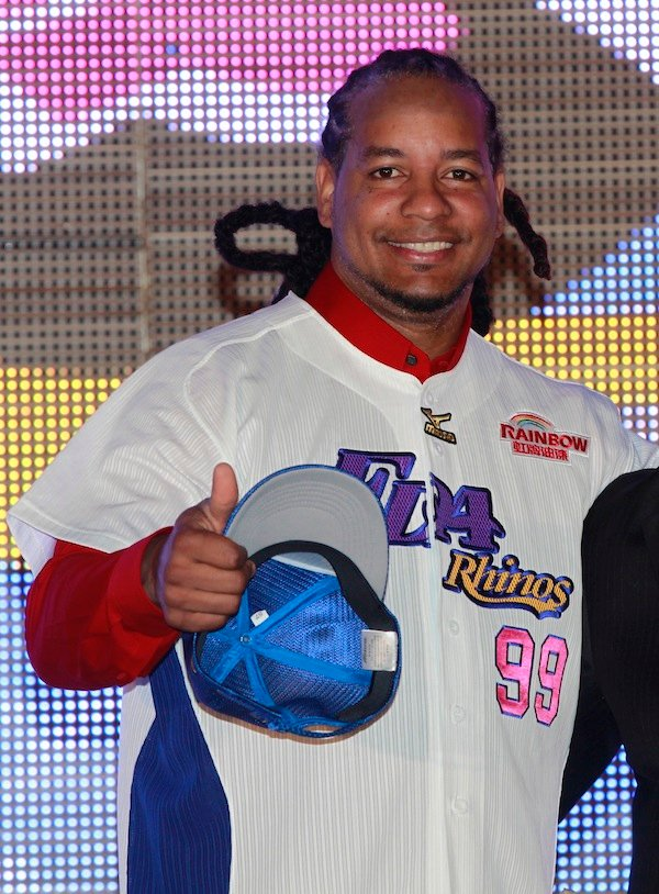 In this March 12, 2013 file photo, former Major League Baseball star Manny Ramirez poses for media wearing his new jersey after signing a short-term contract to play on the EDA Rhinos in Taiwan's professional baseball league, in Kaohsiung, Taiwan. The Texas Rangers have signed Ramirez to minor league contract. Ramirez spent three months playing in Taiwan before leaving the team on June 20. The Rangers made the announcement Wednesday, July 3, 2013. (AP Photo/Wally Santana, File)