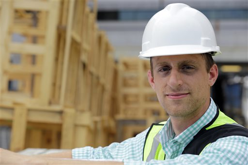 """Drew Miller, shown here at a building under construction on Wednesday in Silver Spring, Md., quit a steady government job to take a chance on a company that's using """"smart technologies"""" to help big corporations cut lighting costs."""