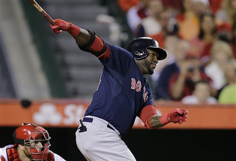 Red Sox DH David Ortiz hits a two-run home run against the Los Angeles Angels in the eighth inning in Anaheim, Calif., on Friday.
