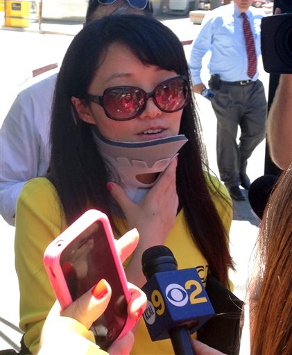 Survivor Fei Xiong of China speaks to the media in San Francisco on Sunday. As Asiana Flight 214 was coming in low over San Francisco Bay, Fei Xiong and her 8-year-old son looked at each other, sensing something was wrong.