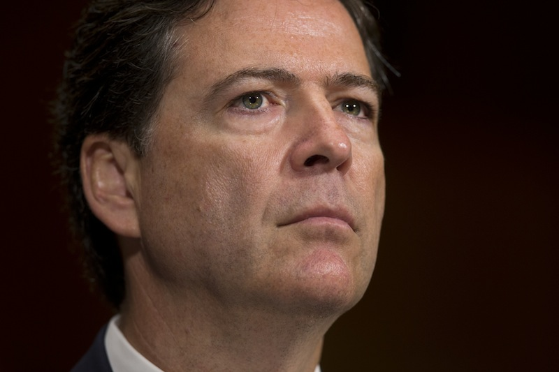 In this July 9. 2013 file photo, FBI director nominee James Comey testifies during a Senate Judiciary Committee in Washington. The Senate Judiciary Committee has unanimously approved the nomination of James Comey to be director of the FBI, clearing the way for a full Senate vote. (AP Photo/Evan Vucci)
