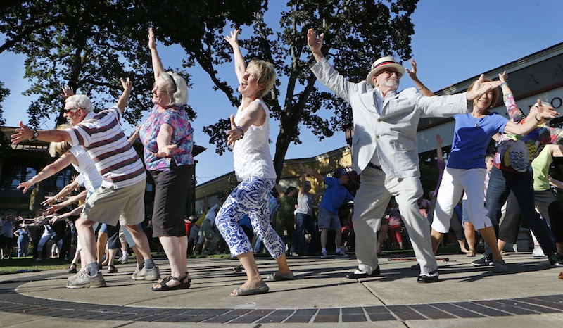 In this July 13 file photo, more than 50 seniors participate in a flash mob dance in Eugene, Oregon. A company that organizes flash mob events around the country will come to Portland in August to stage a high-visibility dance in a public place, but the organizer won't say where. (AP Photo/The Register-Guard, Chris Pietsch)