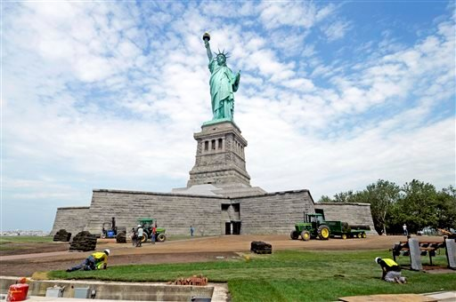 Months after railings broke, docks and paving stones were torn up and buildings were flooded by Superstorm Sandy, the Statue of Liberty reopened today in New York. AP Photo/National Park Service.