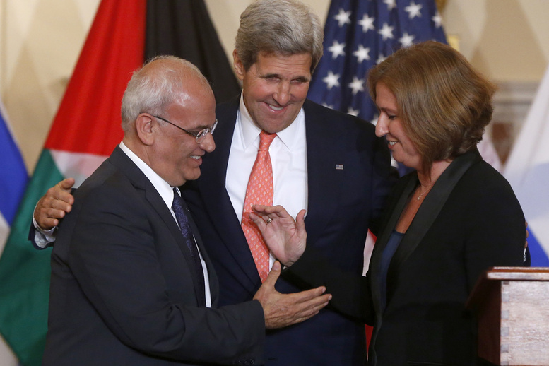 Secretary of State John Kerry stands between Israel's Justice Minister and chief negotiator Tzipi Livni, right, and Palestinian chief negotiator Saeb Erekat, as they shake hands after the resumption of Israeli-Palestinian peace talks on Tuesday at the State Department in Washington.