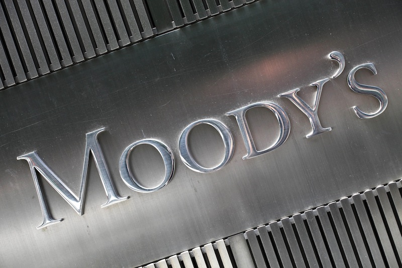 This Aug. 13, 2010 photo shows a sign for Moody's Corp. in New York. Moody's Investors Service upgraded the outlook for U.S. government debt to