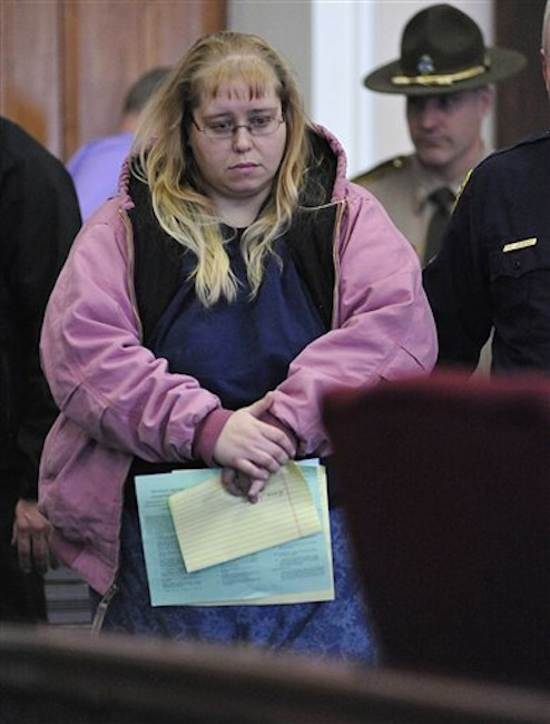 Patricia Prue is led into court Wednesday, March 28, 2012 in St. Johnsbury, Vt. A snow plow driver and his wife are being charged in connection with the killing of a Vermont prep school teacher. (AP Photo/Caledonian-Record, Michael Beniash)