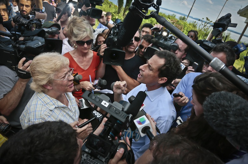 "New York City mayoral candidate Anthony Weiner, right, reacts to a question from Peg Brunda during a tour of Superstorm Sandy victims on Staten Island on Friday, July 26, 2013 in New York. Brunda confronted the candidate, telling him he didn't have the ""moral authority"" to lead the city, as he tries to move past the sexting scandal threatening to derail his attempted political comeback. (AP Photo/Bebeto Matthews)"