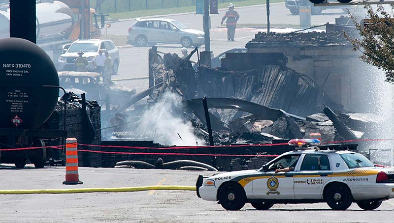 Burnt buildings are seen Sunday following a train derailment causing explosions of railway cars carrying crude oil in Lac Megantic, Quebec. Two more bodies were discovered overnight after a runaway train carrying crude oil derailed in eastern Quebec, igniting explosions and fires that destroyed a town's downtown center. The confirmed death toll is now three, and is expected to rise further. Canada