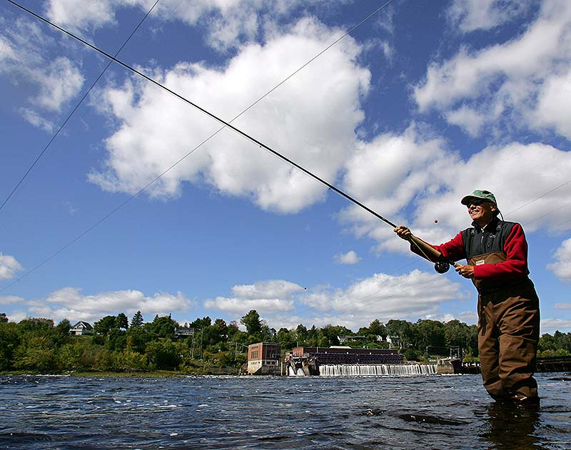 Pete Brunner of Falmouth casts for Atlantic salmon in the Eddington Pool on the Penobscot River below the Veazie Dam in Eddington. Just 20 years ago, the first salmon pulled from the Penobscot River each season was sent to the White House. Now Atlantic salmon have virtually disappeared, and are off limits to fishing. Environmentalists hope a dam removal that starts Monday, opening miles of river to migrating fish, will help efforts to restore endangered salmon.