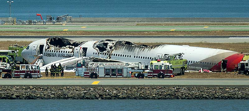 Fire crews respond to the scene where Asiana Flight 214 crashed at San Francisco International Airport on Saturday in San Francisco.