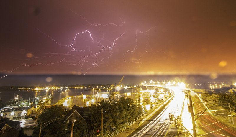 This image of lightning over Casco Bay Bridge was taken Wednesday night by Portland photographer John Kastelein. The photo was taken from a widow's watch on top of 21 State St. Kastelein's photography can be seen at the Hilltop Coffee Shop on Munjoy Hill through July and at his website, www.outworldimages.com.