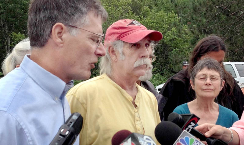 Read Brugger, left, Jim Freeman and Nancy Galland were among a group of demonstrators in Hermon Monday who called for more stringent inspection of Maine railways following the deadly in train derailment in Quebec.