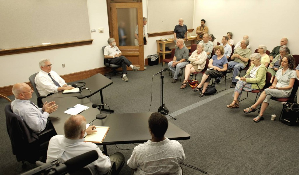 """Portland Mayor Michael Brennan, far left, holds a """"Meet the Mayor"""" session at City Hall Thursday evening for residents to bring up issues that concern them."""