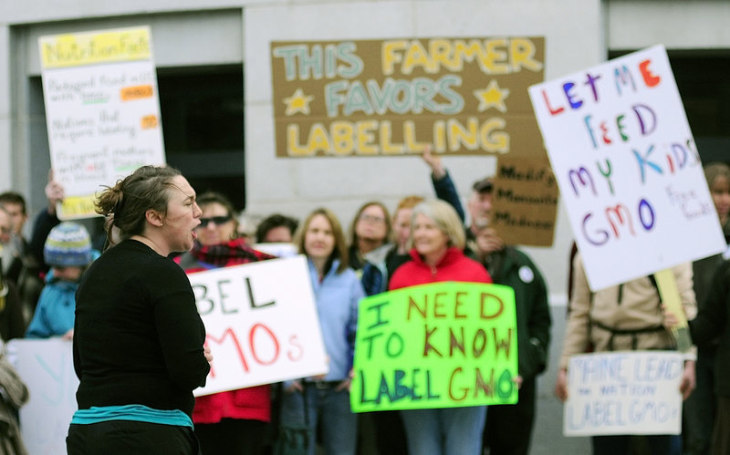 Logan Perkins, Right to Know-GMO Campaign Coordinator for Maine Organic Farmers and Gardeners Association, speaks at a rally outside the Maine State House on Tuesday April 23, 2013. Gov. LePage says he'll sign a bill that would require food producers to label products containing genetically modified ingredients.