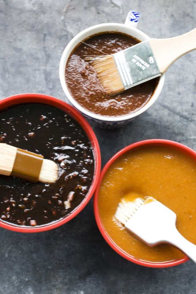 Clockwise from top, recado rojo, tangy apricot barbecue sauce and balsamic strawberry jalapeno barbecue sauce.