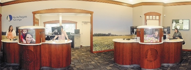 Tellers work behind two pods Friday in the lobby of the new Skowhegan Savings branch on Route 27 in Augusta. The idea behind 'dialogue banking' is to free tellers to have more interaction with customers and present them with options.