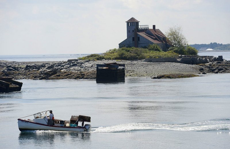 A lobster boat motors past the Wood Island Life Saving Station in Kittery in 2012. The station is vulnerable to demolition by neglect, and other historic Maine structures already have been torn down, a reader says.