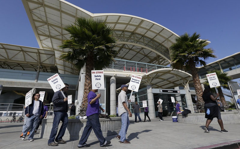 Bay Area Rapid Transit workers picket outside of a station in Millbrae, Calif. The union wants a 5 percent raise each year for three years; BART has offered 8 percent, total, over four years.