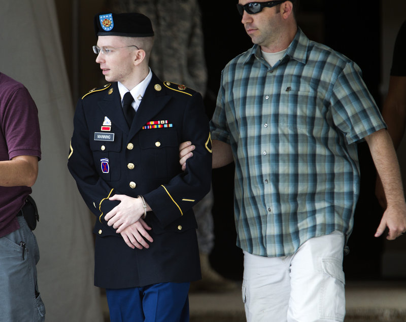 Army Pfc. Bradley Manning is escorted out of the courthouse in Fort Meade, Md., where he is charged with indirectly aiding the enemy by sending classified material to WikiLeaks.