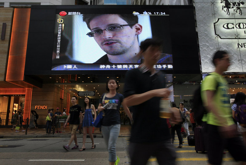 Edward Snowden, who leaked top-secret documents about surveillance programs, is shown on a TV screen in a Hong Kong shopping mall, in a photo taken June 23.