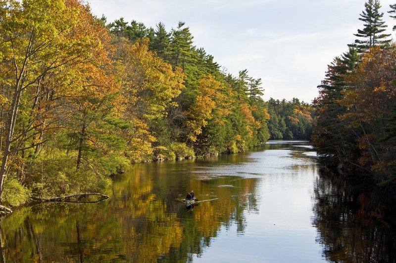 A couple canoes on the Saco River in Hollis in 2007. This stretch of land is known as Indian Cellar because Native Americans once stored their food in caves along a deep gorge there. Land for Maine's Future helped the town buy the property to protect it from development. Gov. LePage's refusal in 2012 to issue voter-approved LMF bonds has held up similar projects.