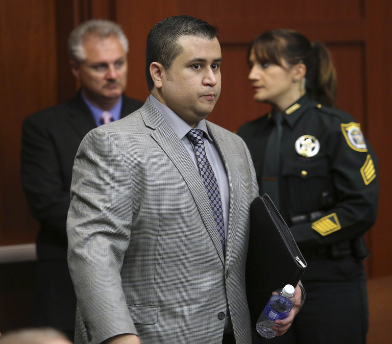 George Zimmerman arrives for the 17th day of his trial in Sanford, Fla., on Tuesday. He is charged with second-degree murder in the fatal shooting of Trayvon Martin.
