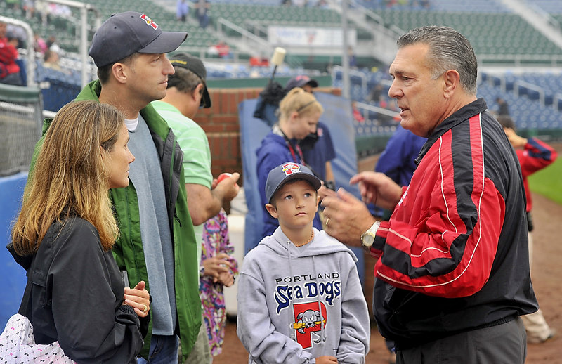 Bernie Carbo, right, talks with Jana and Scott Doughty of York, and their son, Luke, 9. Carbo and Luke Doughty threw out first pitches.