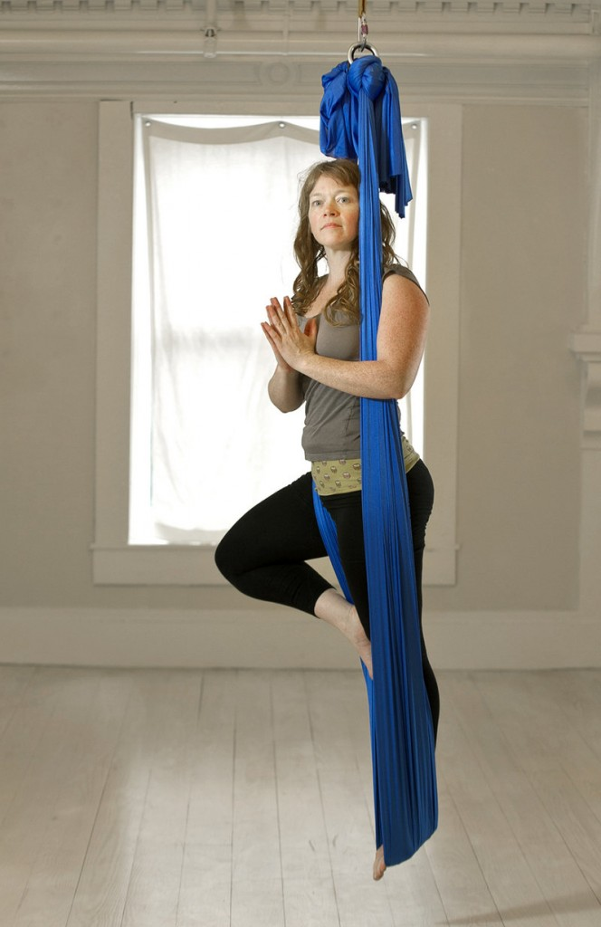 Jannette Hough-Fertig of Apparatus Dance Theater performs the tree pose while doing aerial yoga.