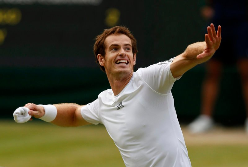 Andy Murray throws his wristband to the crowd Wednesday after climbing out of a two-set hole and reaching the Wimbledon men's semifinals by scoring a 4-6, 3-6, 6-1, 6-4, 7-5 victory against Fernando Verdasco of Spain. Next for Murray: Jerzy Janowicz of Poland.