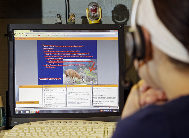 Helen Bukowski, 11, plays a previously recorded live online class on South America at her home, in Akron, Ohio, on April 26. She attends school online through Ohio Connections Academy. Virtual charter schools' mixed record means that the Maine Charter School Commission is smart to take it slow and develop well-thought-out rules for virtual schools.